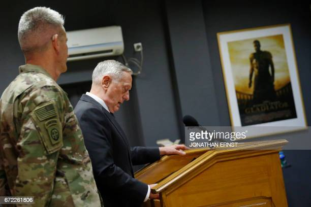 US Defense Secretary James Mattis flanked by US Army General John Nicholson commander of US forces in Afghanistan holds a news conference in a room...
