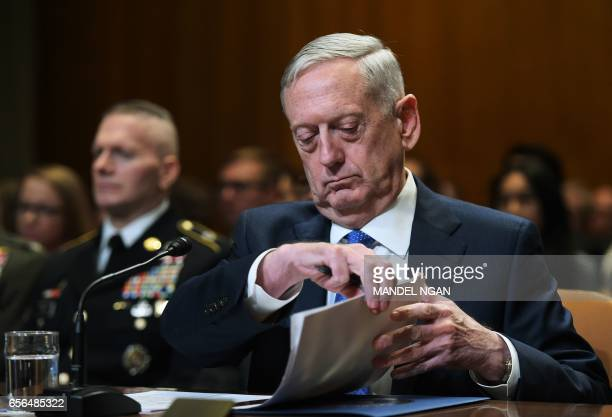 Defense Secretary James Mattis flips through papers during the Senate Appropriations Committee Defense Subcommittee hearing on defense readiness and...