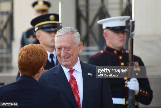 US Defense Secretary James Mattis greets Australia's Defense Minister Marise Payne are she arrives for meetings at the Pentagon in Washington DC on...