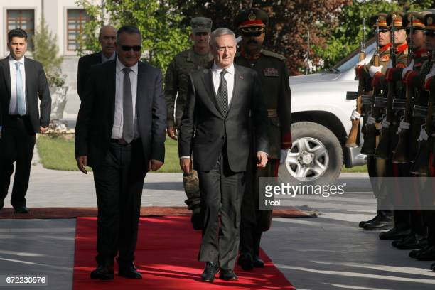 S Defense Secretary James Mattis is greeted by Presidential Palace staff as he arrives to meet with AfghanistanÍs President Ashraf Ghani on April 24...