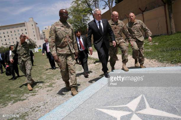 S Defense Secretary James Mattis is greeted by US Army Command Sergeant Major David Clark and General Christopher Haas as he arrives at Resolute...