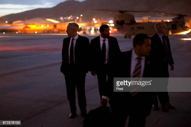S Defense Secretary James Mattis looks out at the tarmac as he boards a US Air Force C17 to depart Hamid Karzai International Airport after a daylong...