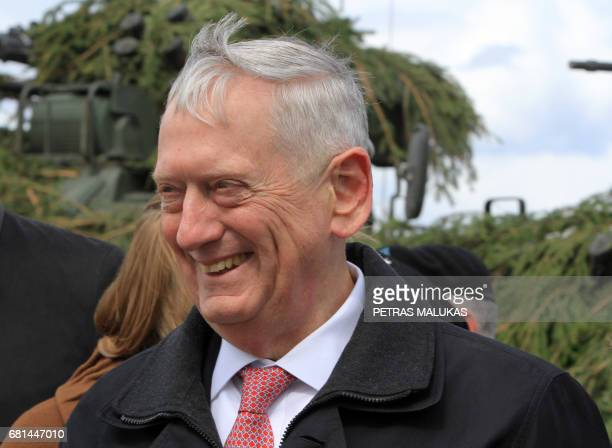 US Defense Secretary James Mattis smiles as he meets with US troops deployed in Lithuania with representatives of the Lithuanian Armed Forces and...