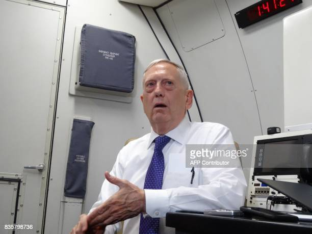 US Defense Secretary James Mattis speaks to reporters on board a flight to Jordan for the start of a regional tour on August 20 2017 / AFP PHOTO /...