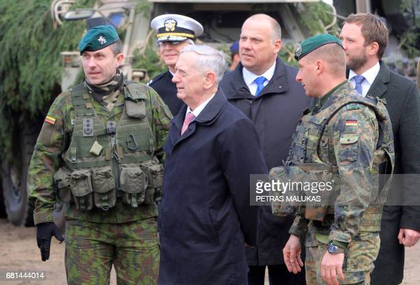 US Defense Secretary James Mattis talks with the Commander of the NATO eFP battalion battlegroup and the German contingent in Lithuania Lieutenant...