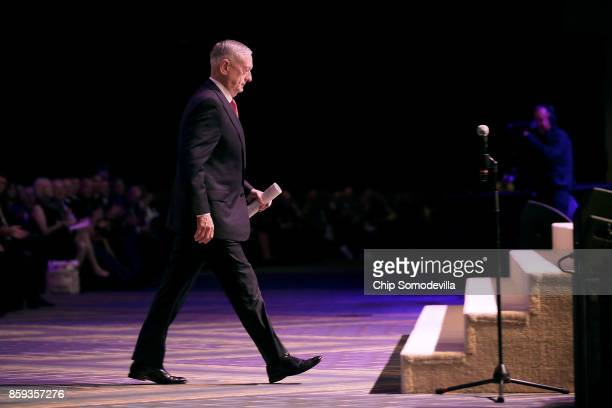 S Defense Secretary James Mattis walks to the stage before delivering the keynote address during the Association of the United States Army's annual...