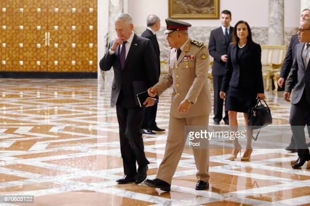 S Defense Secretary James Mattis walks with Egypt's Minister of Defense Sedki Sobhi to meet with Egypt's President Abdel Fattah alSisi at the...