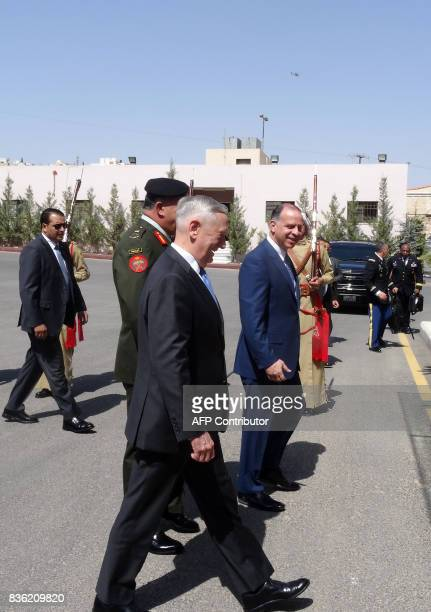 US Defense Secretary James Mattis walks with Jordan's Prince Faisal the brother of King Abdullah II as he is welcomed and escorted to his meeting...