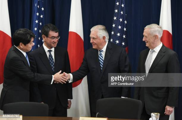 Defense Secretary James Mattis watches as US Secretary of State Rex Tillerson shakes hands with Japan's Defense Minister Itsunori Onodera and Foreign...