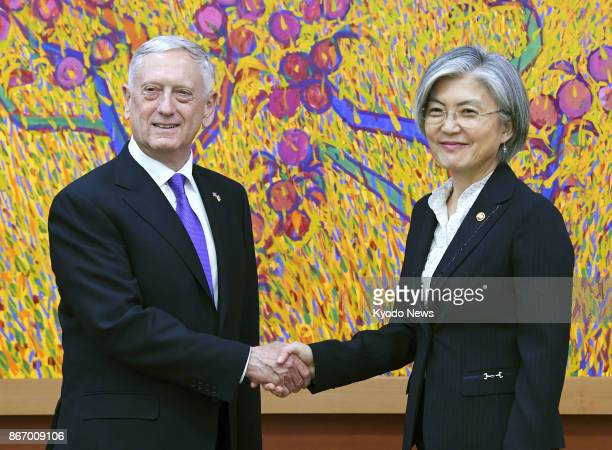 US Defense Secretary Jim Mattis and South Korea's Foreign Minister Kang Kyung Wha shake hands in Seoul on Oct 27 2017 Mattis who arrived in South...
