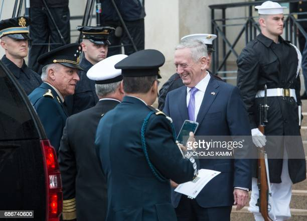 US Defense Secretary Jim Mattis greets Mexican Secretary of the Navy Adm Vidal Francisco Soberon Sanz as Defense Secretary Gen Salvador Cienfuegos...