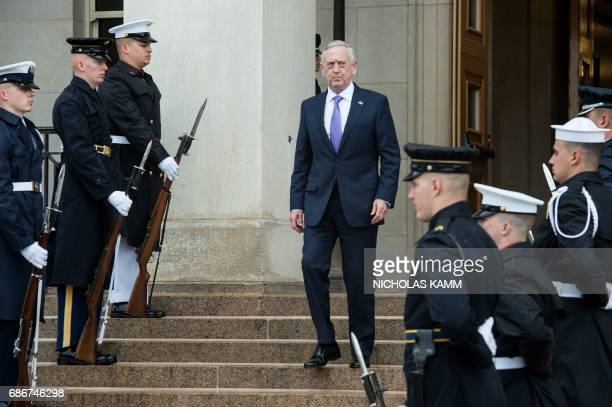 US Defense Secretary Jim Mattis walks down the stairs as he waits for the arrival of Mexican Defense Secretary Gen Salvador Cienfuegos Zepeda at the...