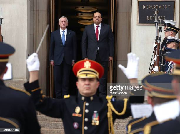 S Defense Secretary Jim Mattis welcome's Qatar Minister of State for Defense Affairs Dr Khalid bin Mohammed alAttiyah during a honor cordon at the...
