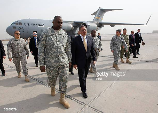 Defense Secretary Leon E Panetta walks with Army General Lloyd Austin Commander of US Forces Iraq during his arrival in Baghdad on December 15 2011...