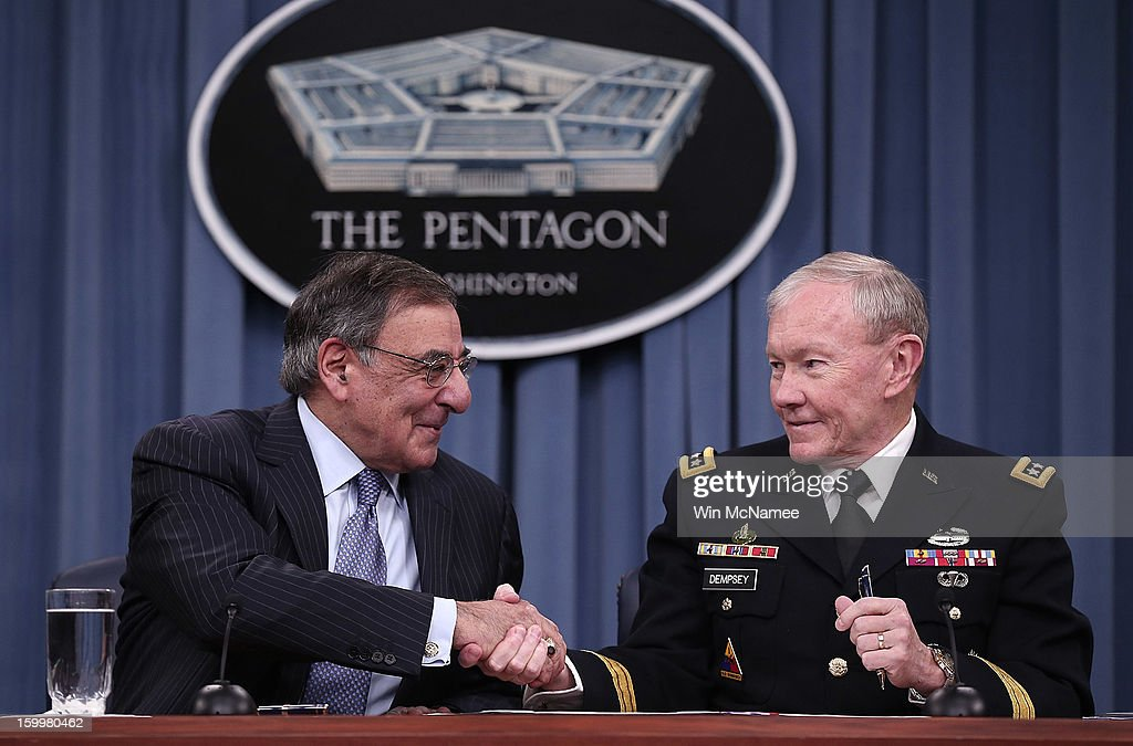 U.S. Defense Secretary Leon Panetta (L) and Chairman of the Joint Chiefs of Staff General Martin Dempsey shake hands after signing orders that will lift a ban on women in combat positions within the U.S. military at the Pentagon January 24, 2013 in Arlington, Virginia. The U.S. Army and the Marine Corps will present plans to open most combat occupations to women by May 15.