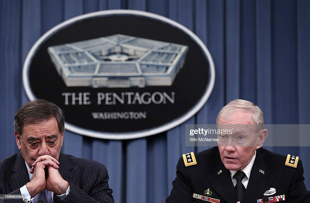 U.S. Defense Secretary Leon Panetta (L) and Chairman of the Joint Chiefs of Staff General <a gi-track='captionPersonalityLinkClicked' href=/galleries/search?phrase=Martin+Dempsey&family=editorial&specificpeople=2116621 ng-click='$event.stopPropagation()'>Martin Dempsey</a> answer questions after signing orders that will lift the ban on women in combat positions within the U.S. military at the Pentagon January 24, 2013 in Arlington, Virginia. The U.S. Army and the Marine Corps will present plans to open most combat occupations to women by May 15.