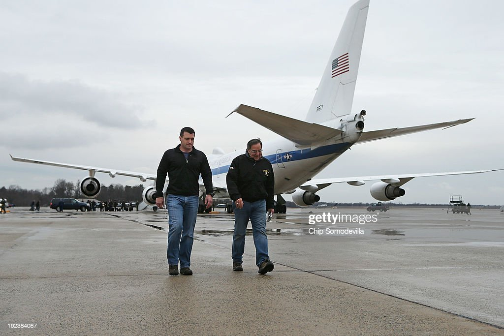S. Defense Secretary Leon Panetta (R) and his military assistant Navy Commander Larry Getz walk across the tarmac and away from the E-4B aircraft after returning from NATO meetings in Brussels February 22, 2013 at Joint Base Andrews, Maryland. If former Sen. Chuck Hagel (R-NE) is confirmed as the new defense secretary in the next few days, Panetta said this would be his last overseas trip as the top civilian at the Pentagon.