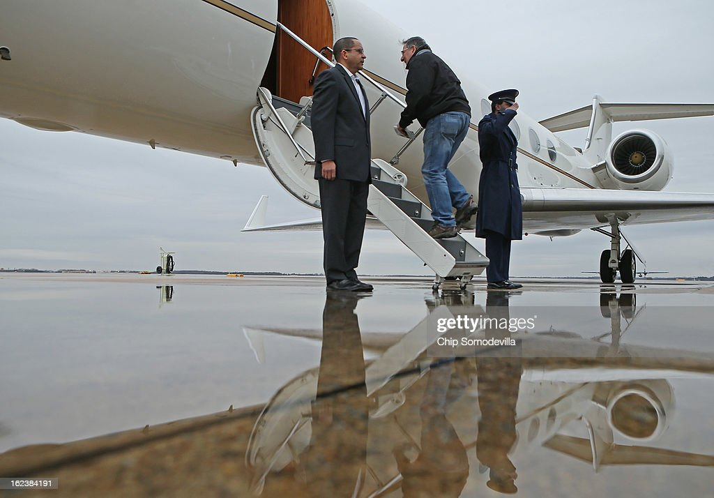 S. Defense Secretary Leon Panetta (C) boards a plane for California after returning from NATO meetings in Brussels February 22, 2013 at Joint Base Andrews, Maryland. If former Sen. Chuck Hagel (R-NE) is confirmed as the new defense secretary in the next few days, Panetta said this would be his last overseas trip as the top civilian at the Pentagon.