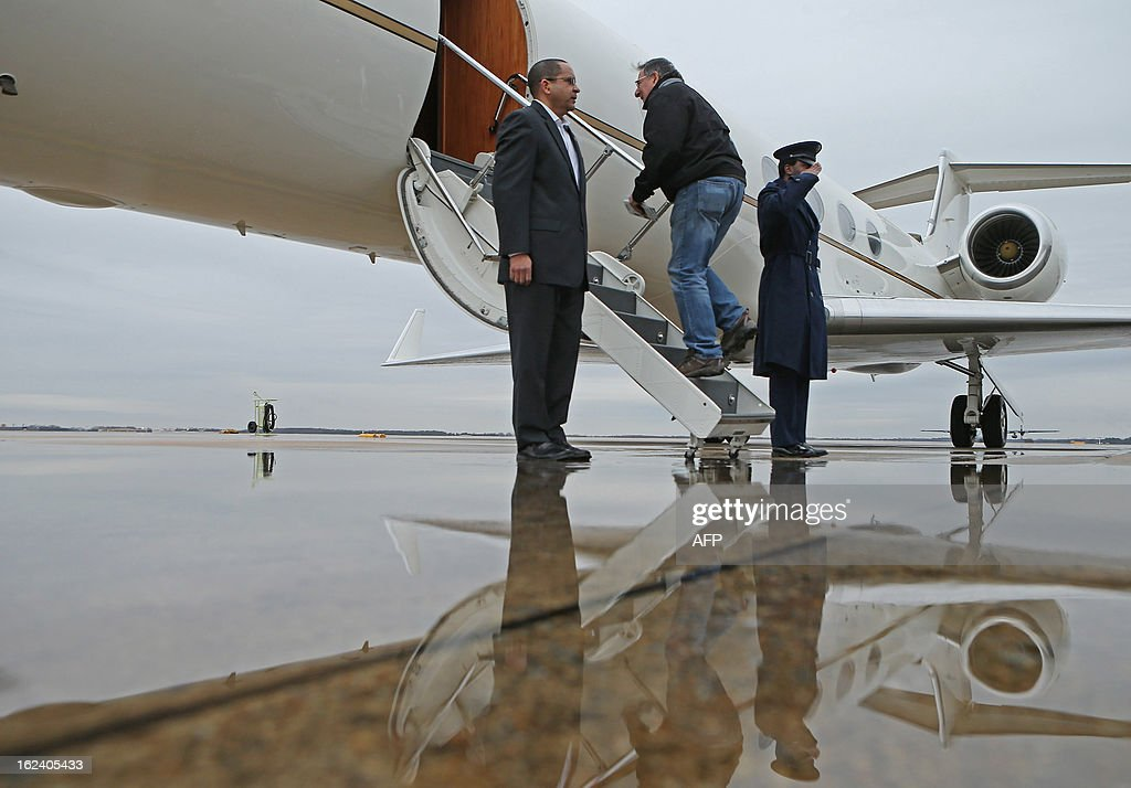 U.S. Defense Secretary Leon Panetta (C) boards a plane for California after returning from NATO meetings in Brussels on February 22, 2013 at Joint Base Andrews, Maryland.