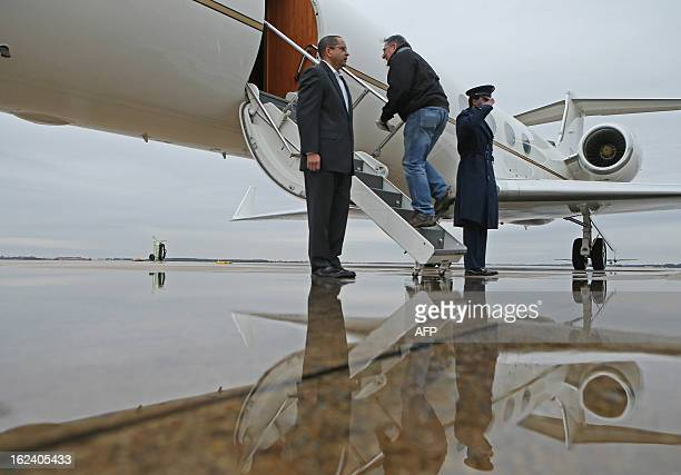 US Defense Secretary Leon Panetta boards a plane for California after returning from NATO meetings in Brussels on February 22 2013 at Joint Base...