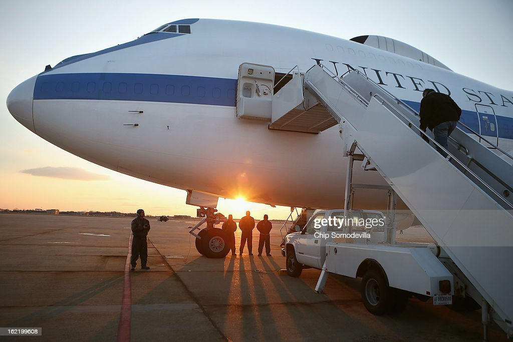 U.S. Defense Secretary Leon Panetta climbs the stairs up to the E-4B aircraft on the tarmac at Joint Base Andrews February 20, 2013 in Maryland. Panetta is traveling to Brussels for a NATO defense ministers meeting.