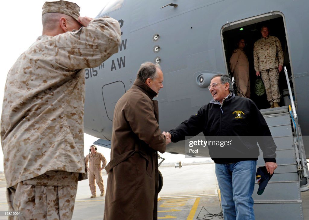 Defense Secretary Leon Panetta (R) is greeted by U.S. Ambassador to Afghanistan James B. Cunningham, (C), as Marine Gen. John R. Allen, (L), commander of International Security Assistance Force salutes upon his arrival at Kabul International Airport on December 12, 2012 in Kabul, Afghanistan. The Defense Secretary is expected to meet with troops to thank them for their service.