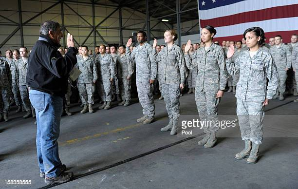 Defense Secretary Leon Panetta performs a swearing in ceremony to reenlist four troops during his visit to Incirlik Air Base on December 14 2012 in...