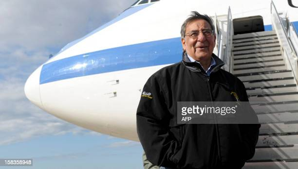 Defense Secretary Leon Panetta poses for a photograph before boarding a plane at Incirlik Air Base in Turkey on December 14 2012 Panetta stopped...