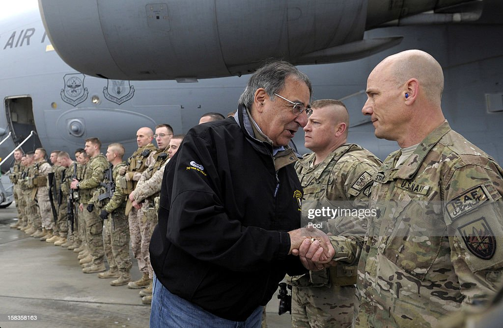 US Defense Secretary Leon Panetta shakes hands with US troops at Kabul International Airport before boarding his plane to return to Washington, on December 14, 2012 in Kabul, Afghanistan. Following the US Defense Secretary's meeting with Afghan president Hamid Karzai and top Afghan officials during his three-day visit to Afghanistan, Secretary Panetta met with US troops and commanders, as the US looks towards a decision on troop numbers once the US-led coalition ends in late 2014.