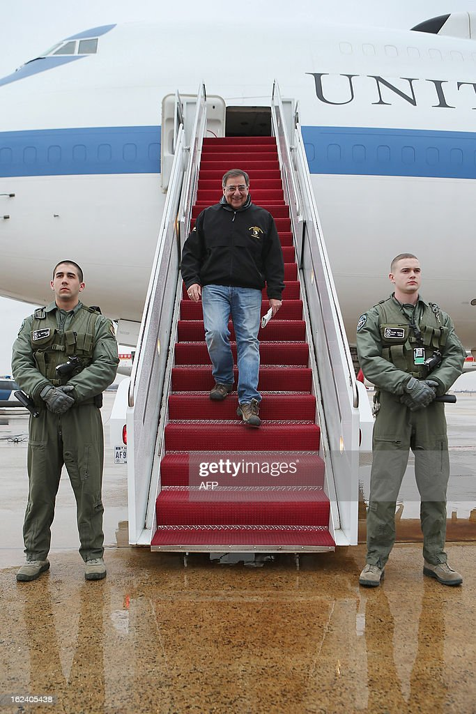 U.S. Defense Secretary Leon Panetta (C) steps off of the E-4B aircraft after returning from NATO meetings in Brussels on February 22, 2013 at Joint Base Andrews, Maryland.