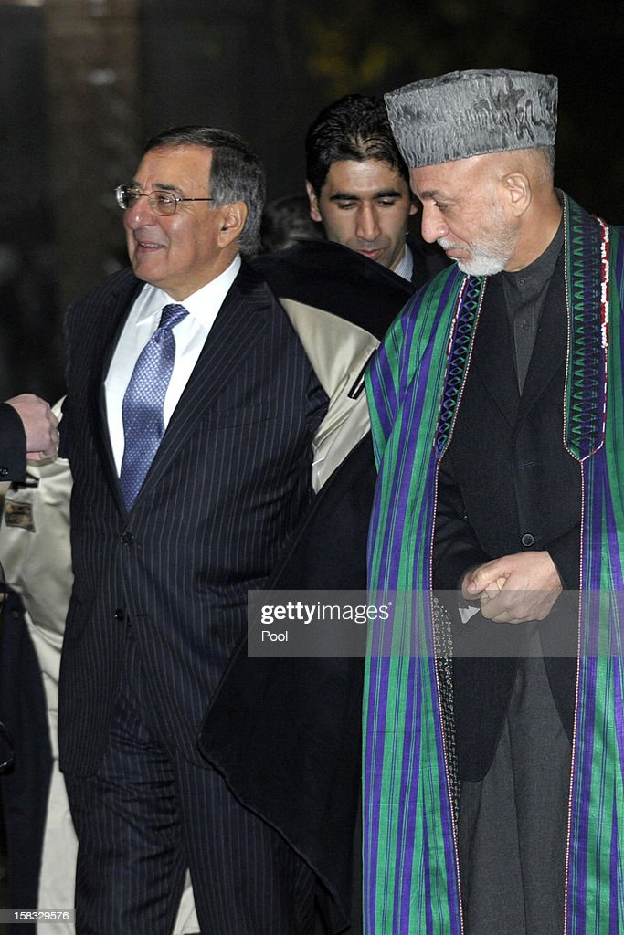 U.S. Defense Secretary Leon Panetta (L) takes off his coat as he and Afghanistan President <a gi-track='captionPersonalityLinkClicked' href=/galleries/search?phrase=Hamid+Karzai&family=editorial&specificpeople=121540 ng-click='$event.stopPropagation()'>Hamid Karzai</a> arrive for a joint news conference at the Presidential Palace on December 13, 2012 in Kabul, Afghanistan. Secretary Panetta is meeting with Afghan president <a gi-track='captionPersonalityLinkClicked' href=/galleries/search?phrase=Hamid+Karzai&family=editorial&specificpeople=121540 ng-click='$event.stopPropagation()'>Hamid Karzai</a> and top Afghan officials as the U.S. look towards a decision on troop numbers once the U.S.-led coalition ends in late 2014.