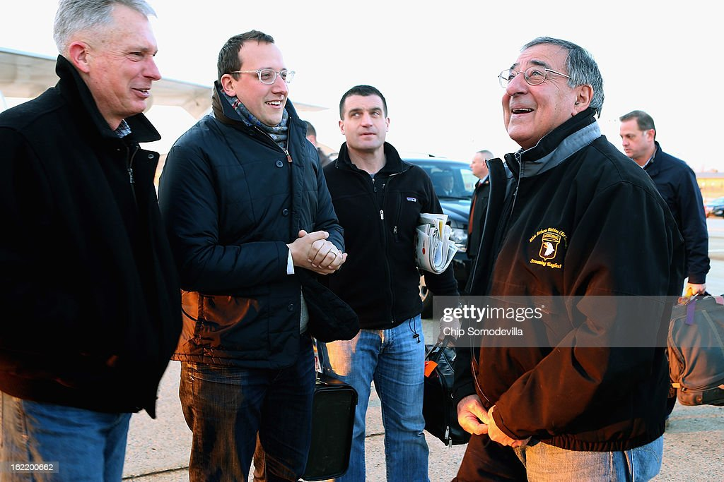 U.S. Defense Secretary Leon Panetta (R) talks with USMC Lt. Gen. Thomas Waldhauser (L) and Assistant Press Secretary Carl Woog (2nd L) before boarding the E-4B aircraft on the tarmac at Joint Base Andrews February 20, 2013 in Maryland. Panetta is traveling to Brussels for a NATO defense ministers meeting.