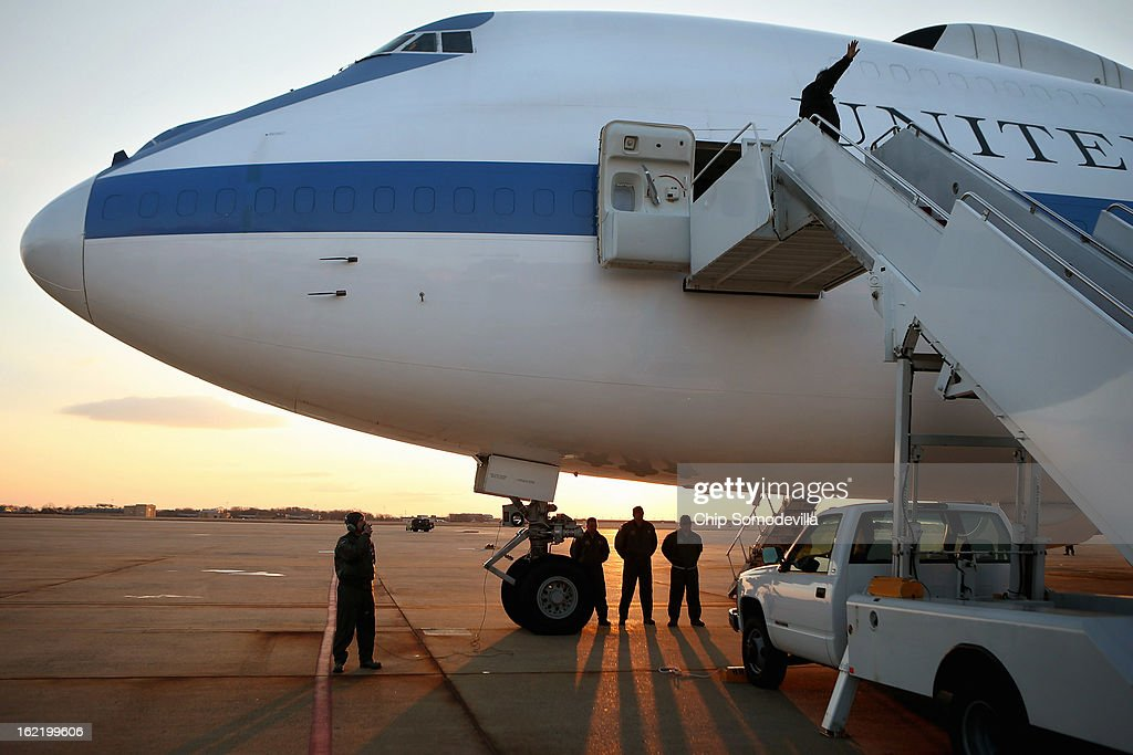 U.S. Defense Secretary Leon Panetta turns to wave before boarding the E-4B aircraft on the tarmac at Joint Base Andrews February 20, 2013 in Maryland. Panetta is traveling to Brussels for a NATO defense ministers meeting.