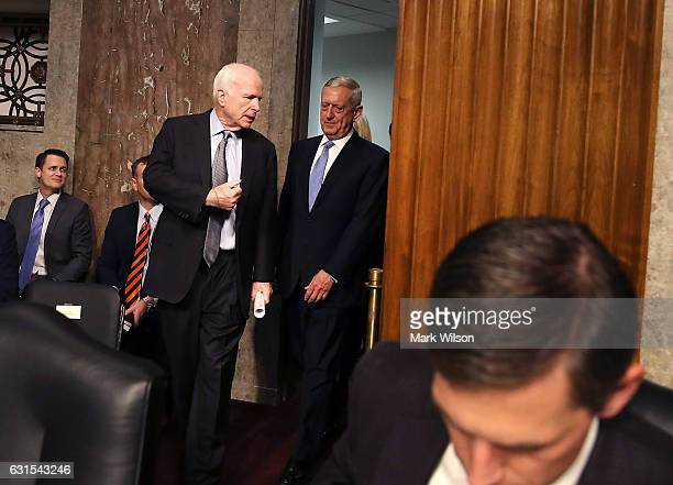 Defense Secretary nominee retired Marine Corps Gen James Mattis walks into his Senate Armed Services Committee confirmation hearing with Chairman...