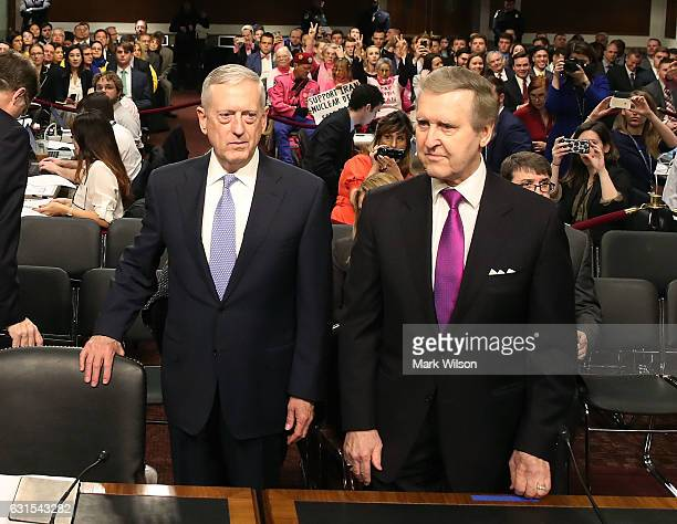 Defense Secretary nominee retired Marine Corps Gen James Mattis stands with Former Defense Secretary William Cohen during his Senate Armed Services...