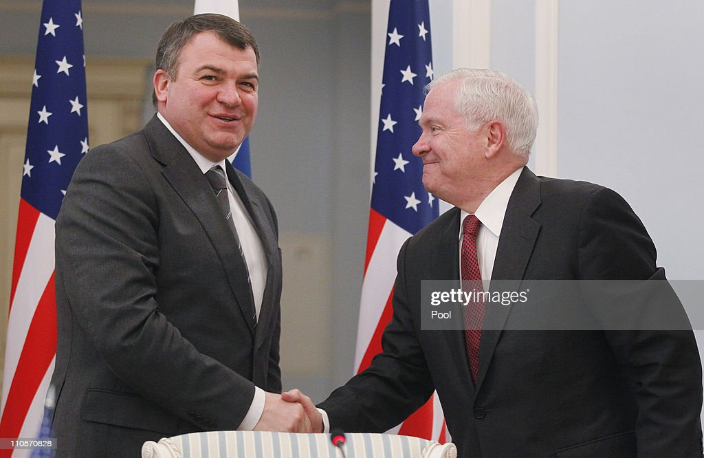 U.S. Defense Secretary Robert Gates (R) and Defense Minister <a gi-track='captionPersonalityLinkClicked' href=/galleries/search?phrase=Anatoly+Serdyukov&family=editorial&specificpeople=4162784 ng-click='$event.stopPropagation()'>Anatoly Serdyukov</a> shake hands after holding a press conference on March 22, 2011 in St. Petersburg, Russia. Gates is scheduled to meet with Russian President Dmitry Medvedev during his visit.