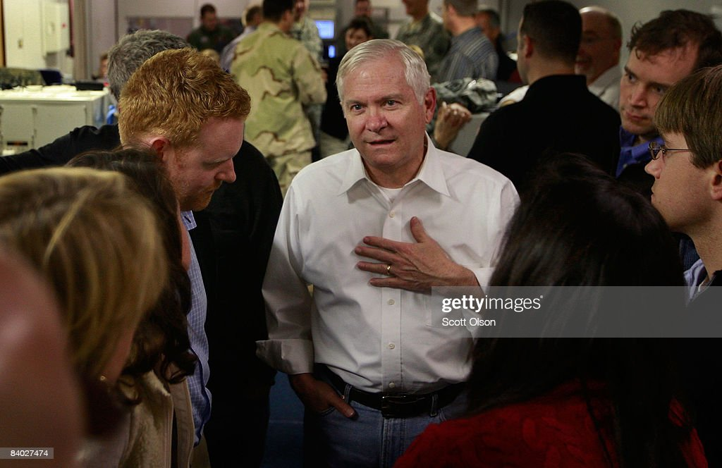 U.S. Defense Secretary Robert Gates (C) chats with members of his staff, and flight crew as they travel after leaving Incirlik Air Base on December 13, 2008 from Incirlik, Turkey. Gates was changing planes in Turkey after flying out of Balad, Iraq, the last leg of a four-day Middle East tour.