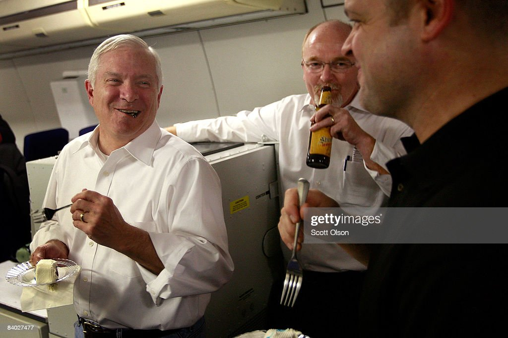 U.S. Defense Secretary Robert Gates (L) chats with members of his staff, and flight crew as they travel after leaving Incirlik Air Base on December 13, 2008 from Incirlik, Turkey. Gates was changing planes in Turkey after flying out of Balad, Iraq, the last leg of a four-day Middle East tour.