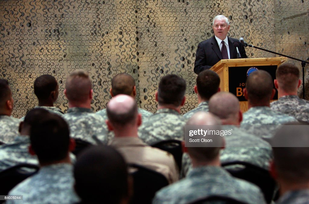 U.S. Defense Secretary Robert Gates speaks to troops at Joint Base Balad during a town hall meeting December 13, 2008 in Balad, Iraq. Gates is in Iraq wrapping up a four-day tour of the Middle East meeting with regional commanders and troops.