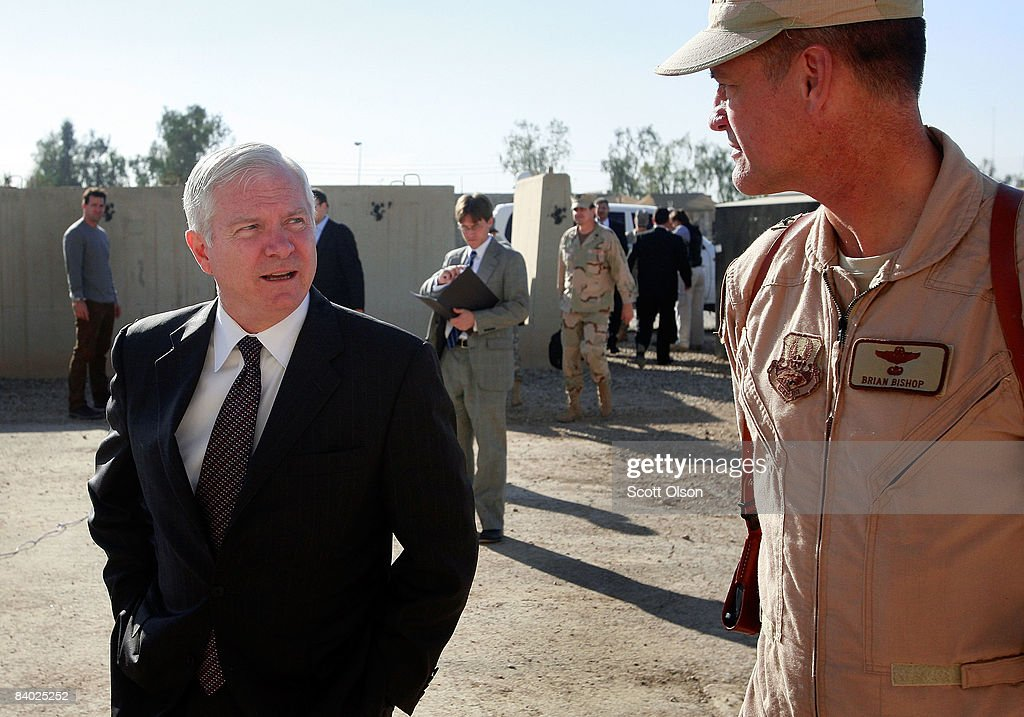 U.S. Defense Secretary Robert Gates (L) speaks with Brigadier General Brian Bishop prior to meeting with troops at Joint Base Balad December 13, 2008 in Balad, Iraq. Gates is in Iraq wrapping up a four-day tour of the Middle East meeting with regional commanders and troops.