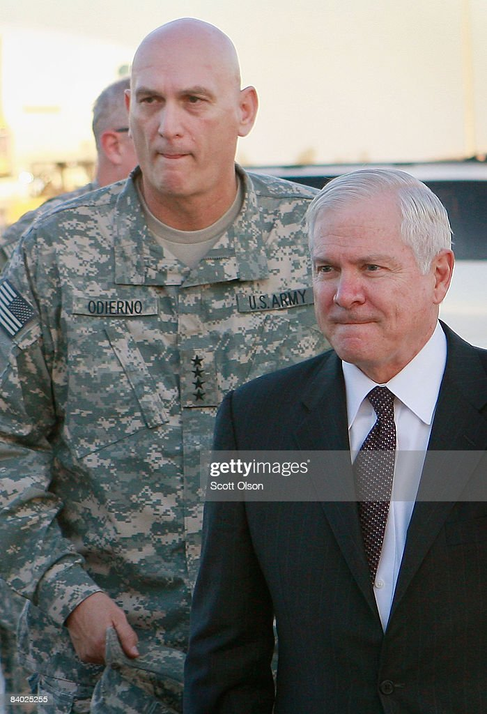 U.S. Defense Secretary Robert Gates (R) walks with General Ray Odierno, commander of multi-national forces Iraq following a town hall meeting with troops December 13, 2008 in Balad, Iraq. Gates stopped in Iraq to wrap up a four-day tour of the Middle East where he met with regional commanders and talked with troopss.