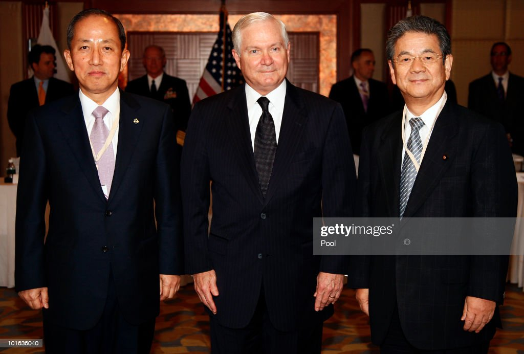 U.S. Defense Secretary Robert M. Gates (C) Japan's Minister of Defense Toshimi Kitazawa (R) and South Korean Defense Minister Kim Tae Young (L) stand together during a meeting at the Shangri-La Dialogue's Asia Security Summit on June 5, 2010 in Singapore. Gates is visiting five countries in his participation with the major Asian security conference in Singapore. In addition to Singapore, the secretary will travel to Azerbaijan, England, Belgium and Germany.