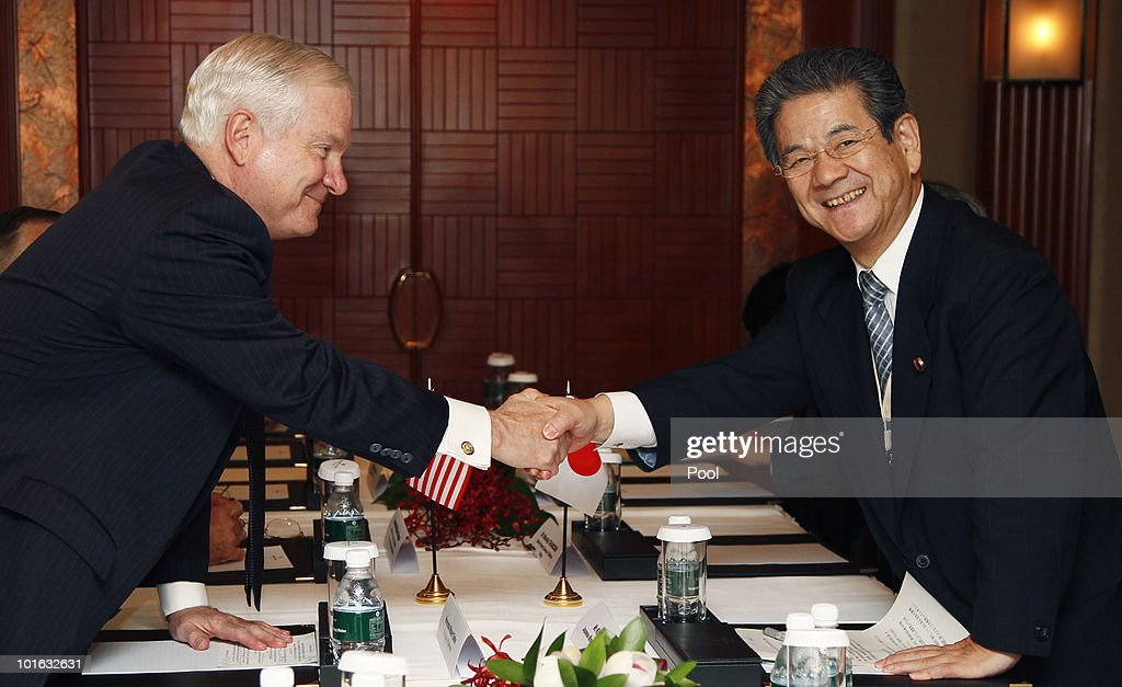 U.S. Defense Secretary Robert M. Gates shakes hands Japan's Minister of Defense Toshimi Kitazawa at the Shangri-La Dialogue Asia Security Summit on June 5, 2010 in Singapore. The 9th IISS Asia Security Summit will run from June 4 to 6, 2010.