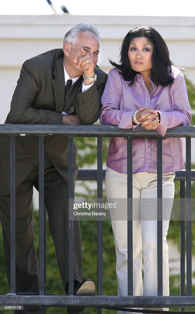 Defense team member Scott Ross (L) and defense witness Monica De Los Santos (R) look out over the Santa Barbara County Courthouse grounds while Michael Jackson's child molestation trial is in proceedings May 23, 2005 in Santa Maria, California. Jackson is charged in a 10-count indictment that included molesting a boy, plying him with liquor and conspiring to commit child abduction, false imprisonment and extortion. He has pleaded innocent.