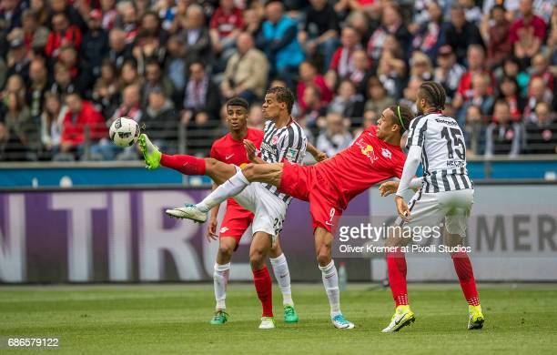 Defense Timothy Chandler of Eintracht Frankfurt and Forward Yussuf Yurary Poulsen of RB Leipzig fighting for the ball at the Commerzbank Arena during...