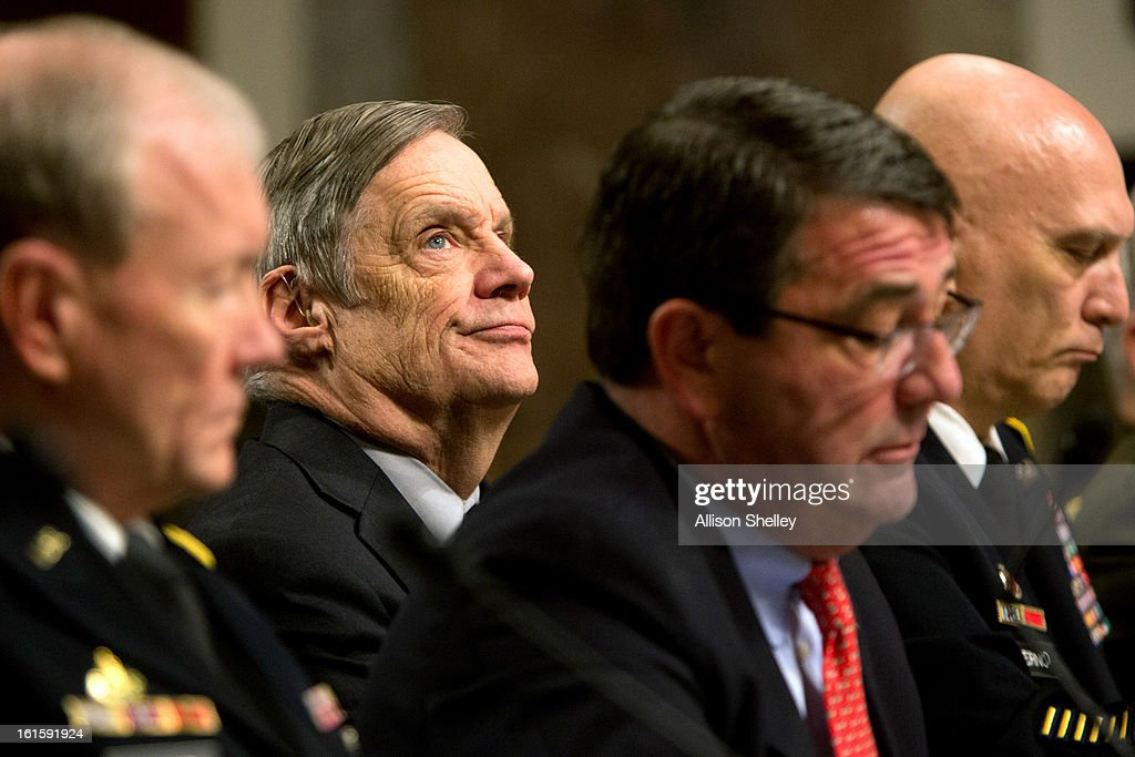 Defense Undersecretary Robert Hale reacts as defense department officials testify before the Senate Armed Services Committee on the impacts of sequestration and/or a full-year continuing resolution on the Defense Department, n Capitol Hill February 12, 2013 in Washington, DC. In order to pay down the deficit the cuts are designed to force savings of $1.2 trillion through 2021.