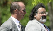 Defense witness Jimmy Van Norman walks with attorney Jesus Castillo as they leave the Santa Barbara County Courthouse May 11 2005 in Santa Maria...