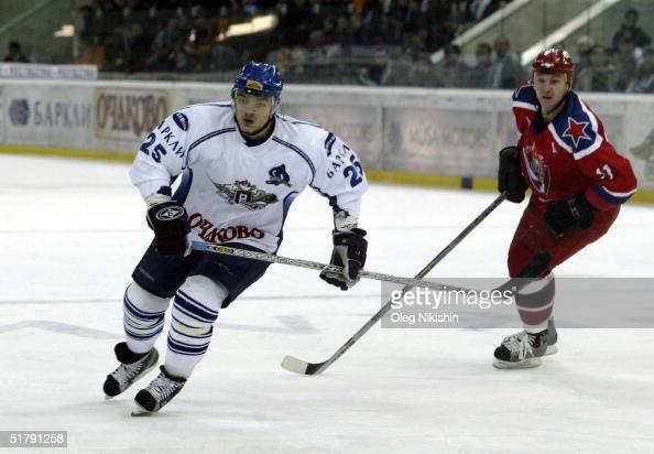 Defenseman Andrei Markov of Dynamo Moscow skates against forward Andrei Nikolishin of CSKA Moscow on November 24 2004 at Luzhniki Ice Arena in Moscow...