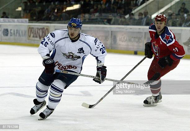 Defenseman Andrei Markov of Dynamo Moscow skates against forward Andrei Nikolishin of CSKA Moscow on November 24 2004 at Luzhniki Ice Arena in Moscow...
