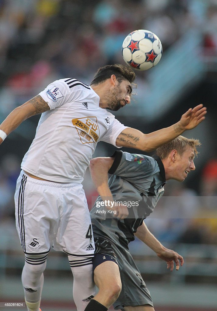 Defenseman Chico Flores of Swansea City heads a ball against forward Greg Jordan of Minnesota United FC on July 19 2014 at the National Sports Center...